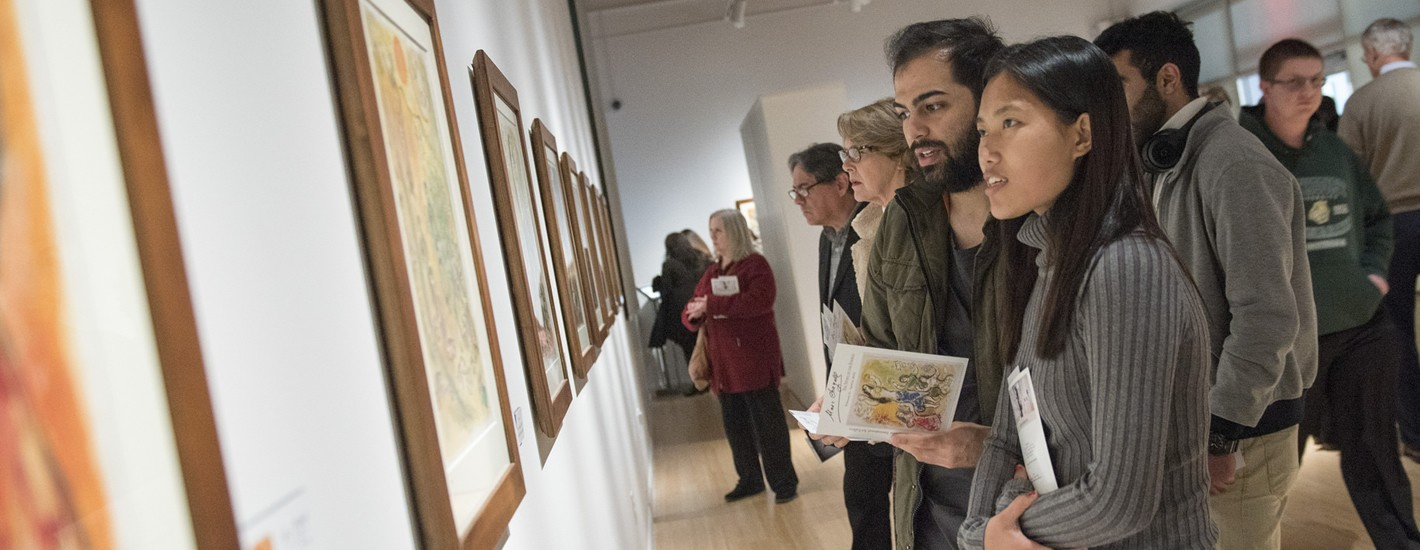 Visitors marvel at the works of Marc Chagall on display at the McCune Gallery Spring 2018