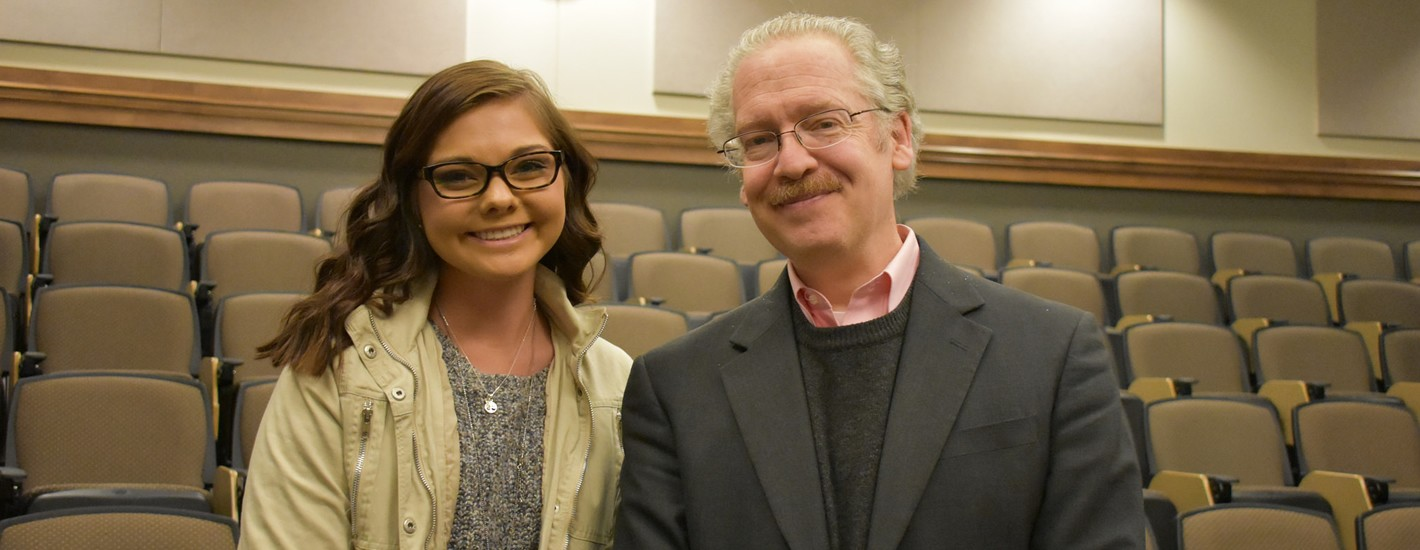Bullard-Templeton Lecturer Dr. Lawrence Principe poses with a student