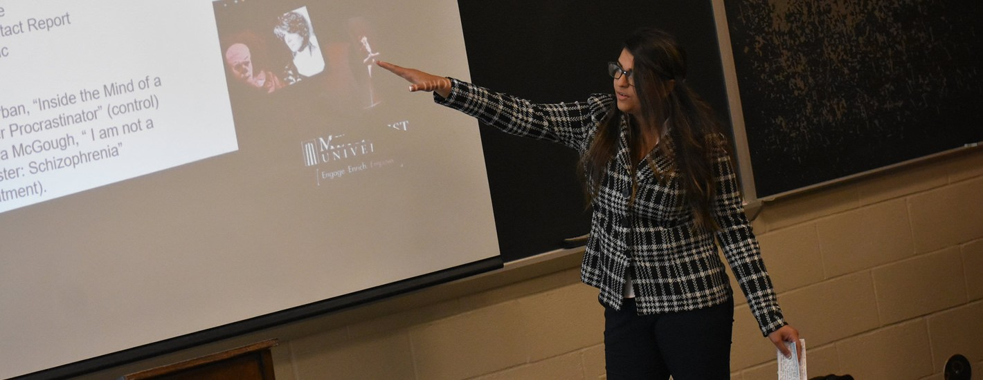 A Psychology student presents during the annual Research Symposium