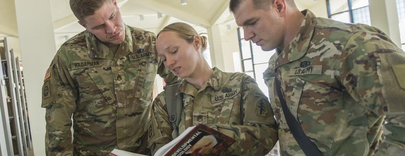 Army ROTC Cadets doing research in Davis Memorial Library