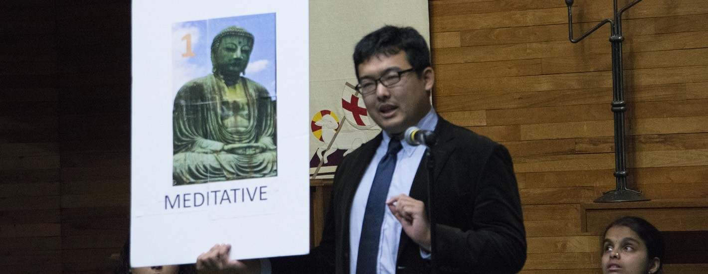 Student discusses Buddhism at an Interfaith event