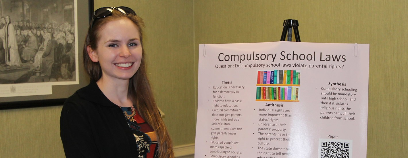 A student presents her research at the annual research symposium