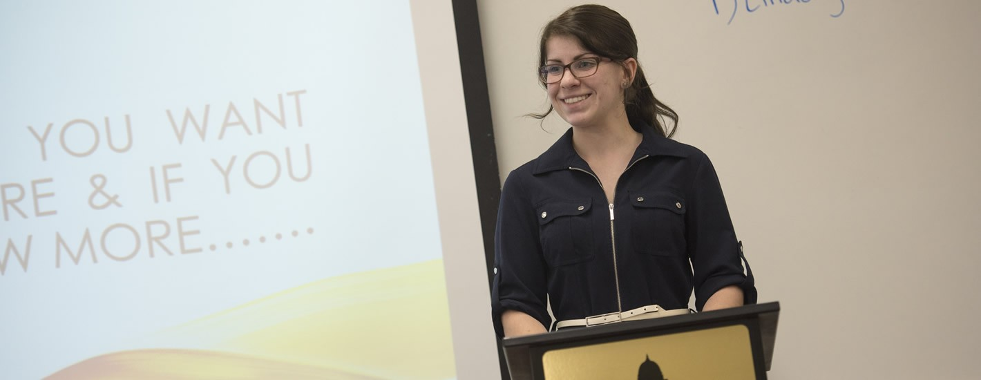 Student speaks in a research presentation