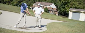 Coach Steve Conley works with a student in the bunker