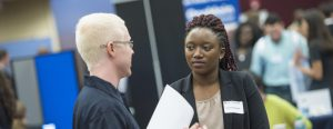 A student visits a career fair at Methodist University.