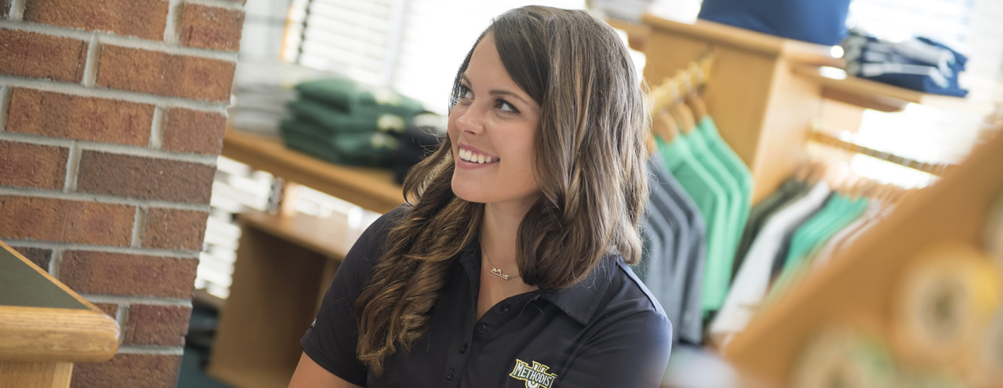 A student works in the MU Golf Shop