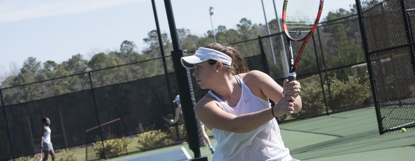 Student on the courts at the Gene Clayton Tennis Center