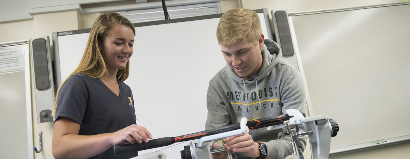 Students work on racquet repair