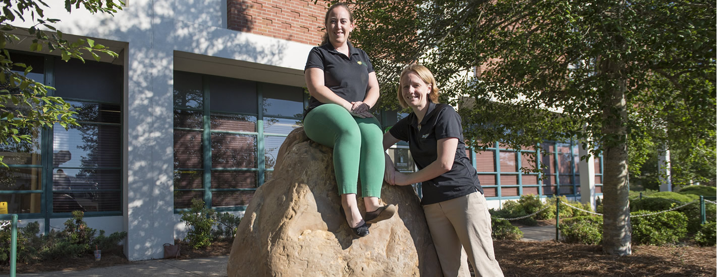 Student Involvement Center staff pose with the Spirit Rock