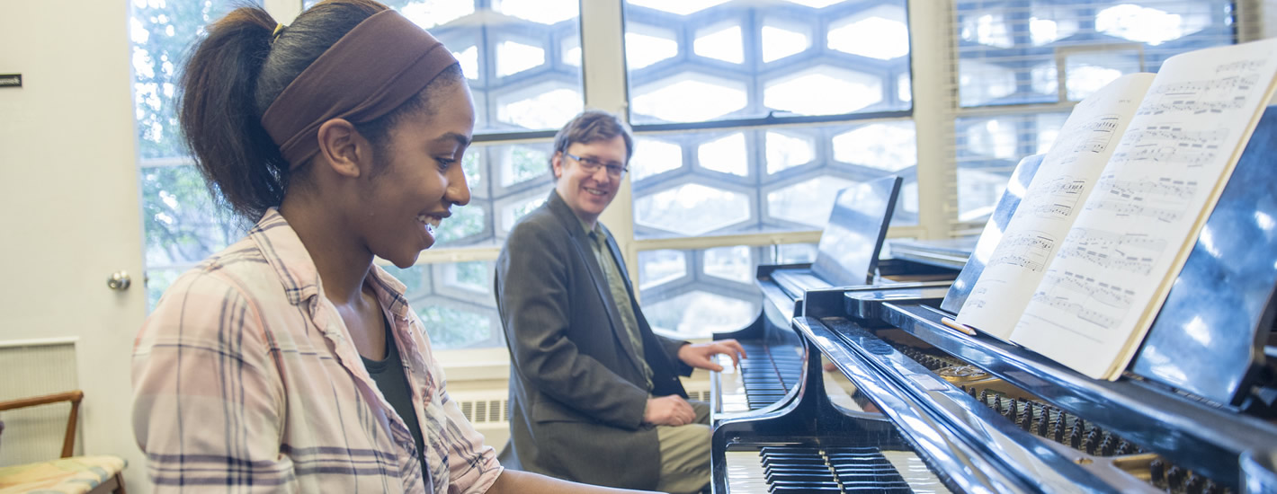 Dr. Scott Marosek works with a student in the Piano Lab