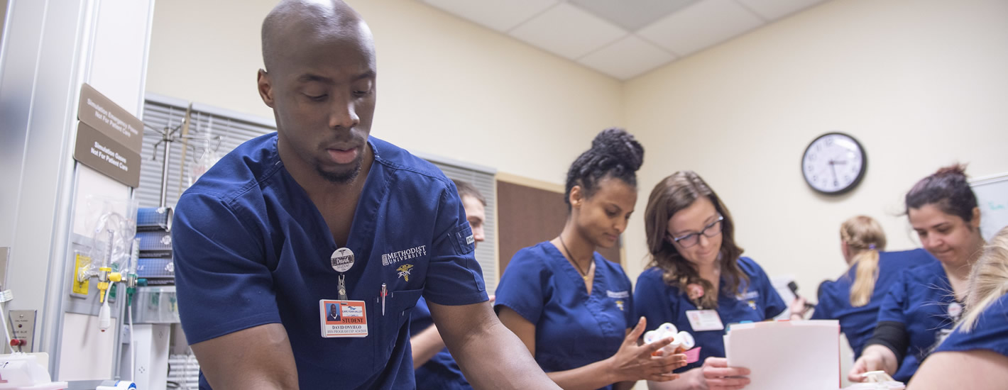 Nursing students participate in a simulation