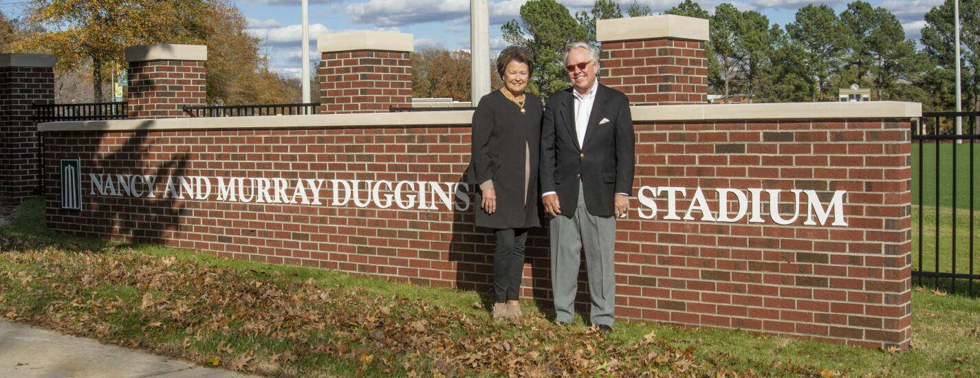 Nancy & Murray Duggins with the stadium sign