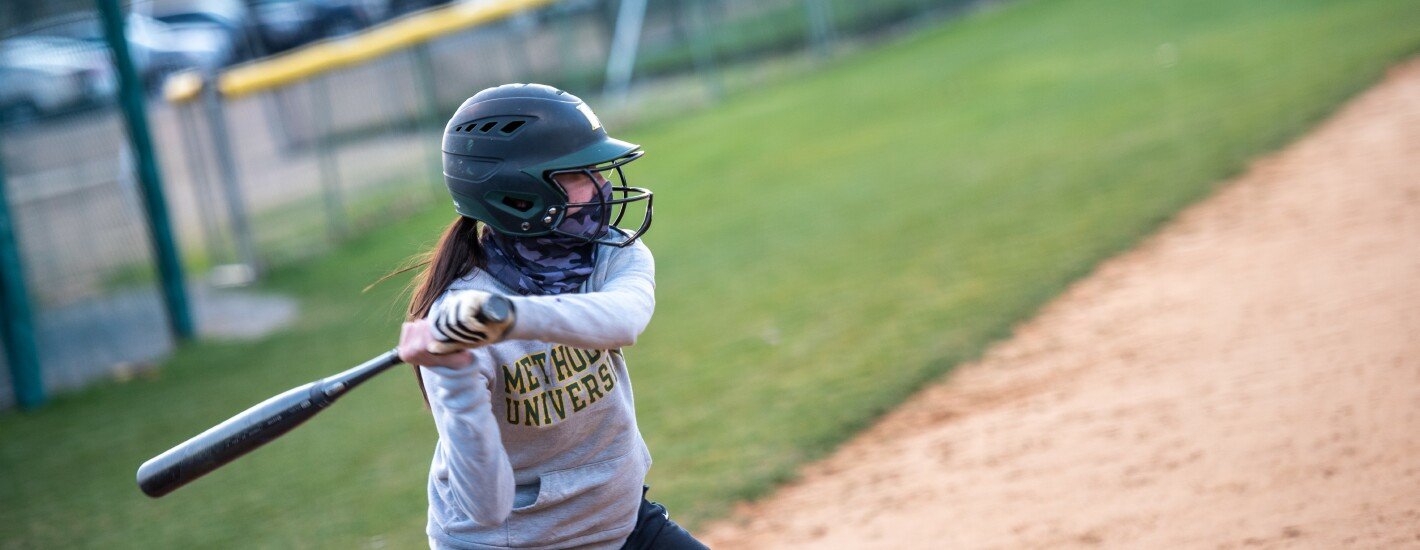A softball player prepares to swing