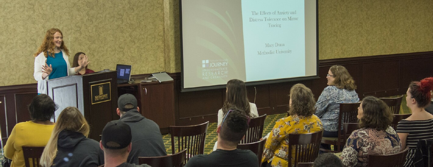 A student presents at the annual CRC Symposium